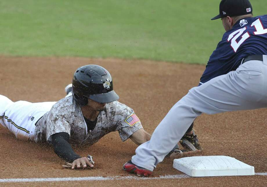 Kaleb Cowert of the Travelers tags out the Missions' Rico Noel to end the first inning. Noel still finished 3 for 4 to help the Missions end a two-game slide. Photo: Billy Calzada / San Antonio Express-News