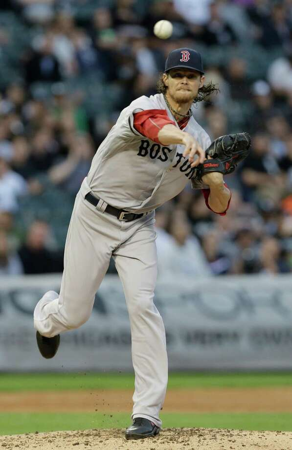 Boston Red Sox starter Clay Buchholz throws to first base during the first inning of a baseball game against the Chicago White Sox in Chicago, Wednesday, May 22, 2013. (AP Photo/Nam Y. Huh) Photo: Nam Y. Huh
