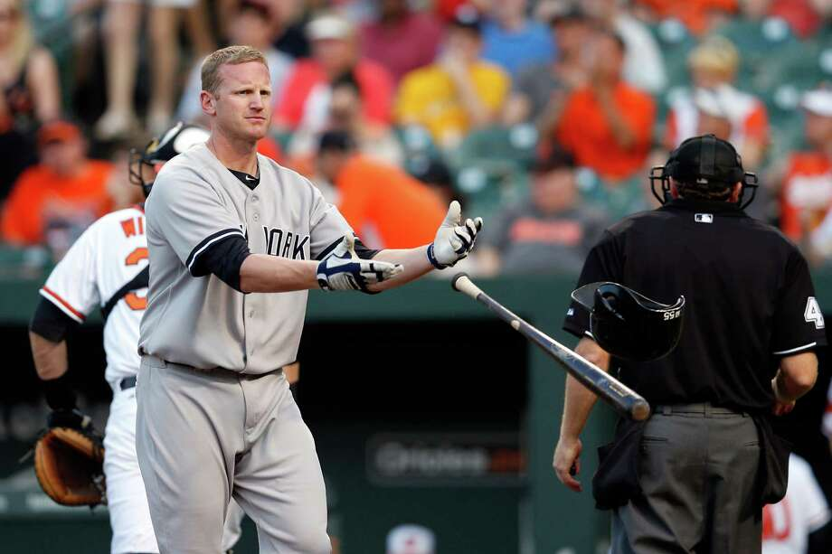 BALTIMORE, MD - MAY 22: Lyle Overbay #55 of the New York Yankees tosses his bat and helmet after striking out swinging for the third out of the first inning against the Baltimore Orioles at Oriole Park at Camden Yards on May 22, 2013 in Baltimore, Maryland.  (Photo by Rob Carr/Getty Images) Photo: Rob Carr
