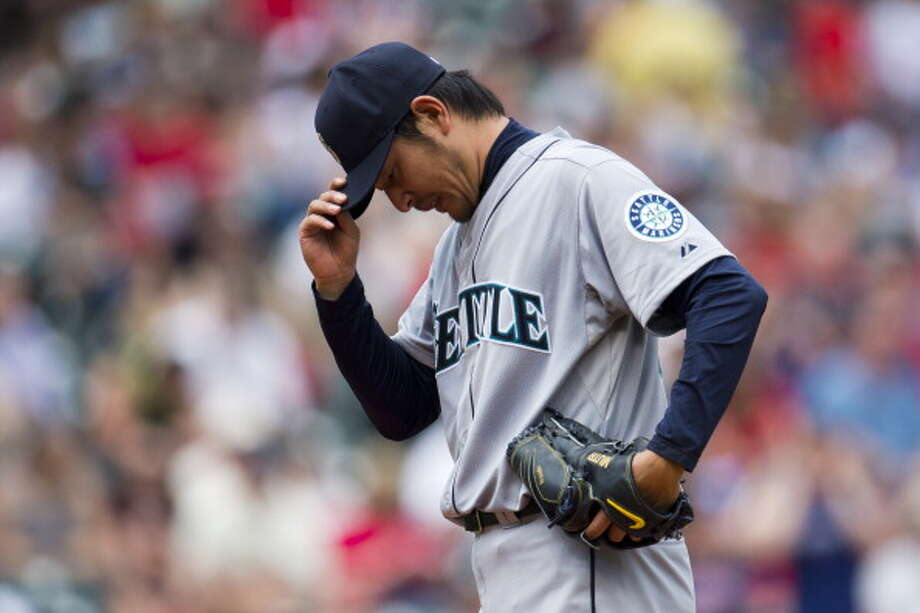 As soon as the Mariners start hitting well, their pitching goes down the drain.  Photo: Jason Miller, Getty Images / 2013 Getty Images