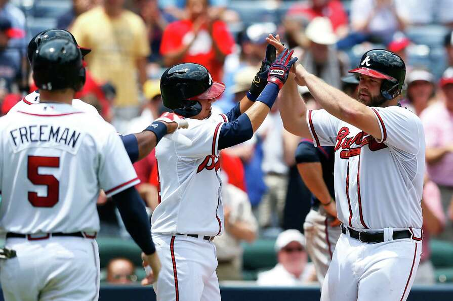 ATLANTA, GA - MAY 22:  Evan Gattis #24 of the Atlanta Braves reacts after hitting a grand slam in th