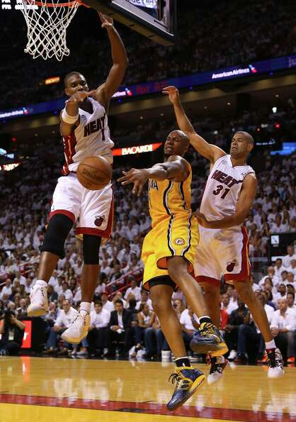 MIAMI, FL - MAY 22:  David West #21 of the Indiana Pacers looks to pass against Chris Bosh #1 and Sh