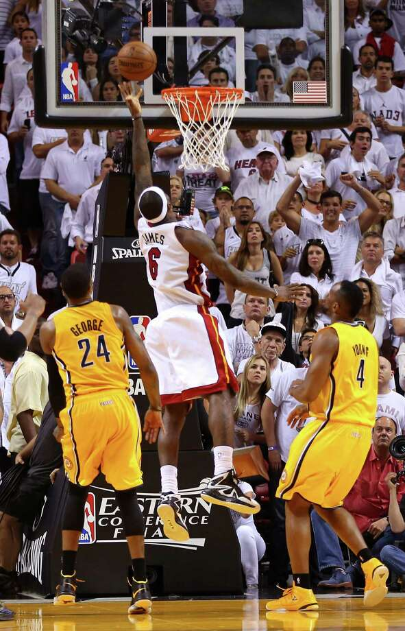 LeBron James finds a hole in the Pacers' defense and just beats the buzzer to give the Heat the win. Photo: Mike Ehrmann, Staff / 2013 Getty Images