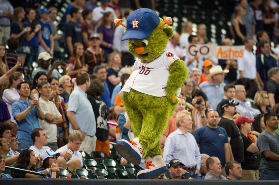 Astros mascot Orbit dances on the dugout during the seventh inning stretch.