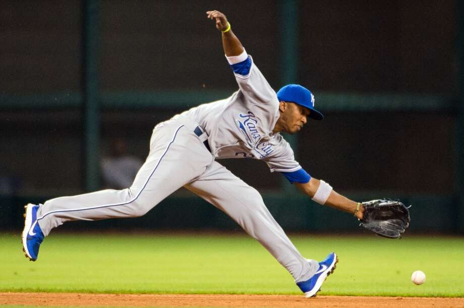 Royals shortstop Alcides Escoba ranges behind the bag as he makes the play on a grounder by Astros center fielder Robbie Grossman during the eighth inning.