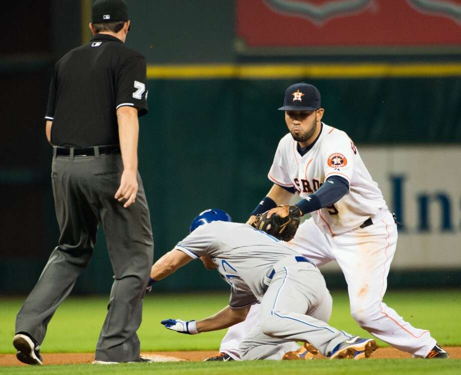 Astros shortstop Marwin Gonzalez applies the tag as Royals second baseman Chris Getz s out at second after being picked off during the eighth inning.