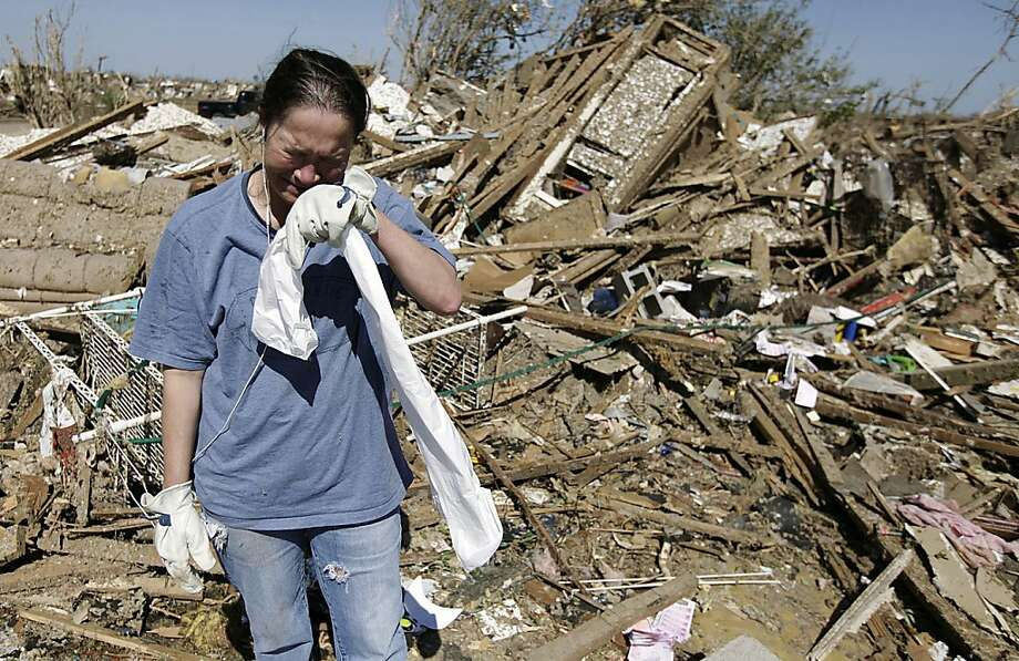 Kriket Krekemeyer cries while cleaning up her tornado-ravaged home in Moore, Okla., Wednesday, May 22, 2013. (AP Photo/Tulsa World, Mike Simons) Photo: Mike Simons, Associated Press