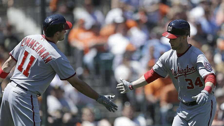 Washington Nationals Ryan Zimmerman (11) congratulates Bryce Harper, right, after Harper hit a home run off San Francisco Giants' Madison Bumgarner in the sixth inning of a baseball game on Wednesday, May 22, 2013, in San Francisco. (AP Photo/Ben Margot) Photo: Ben Margot, Associated Press