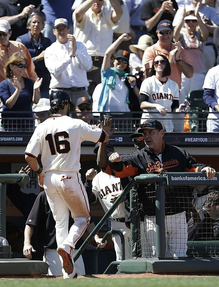 San Francisco Giants' Angel Pagan (16) is congratulated by manager Bruce Bochy after scoring against the Washington Nationals in the eighth inning of a baseball game on Wednesday, May 22, 2013, in San Francisco. (AP Photo/Ben Margot) Photo: Ben Margot, Associated Press