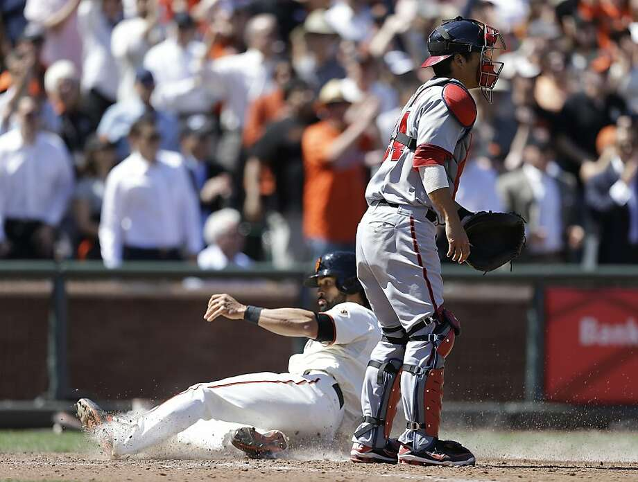 San Francisco Giants' Angel Pagan, left, slides to score past Washington Nationals catcher Kurt Suzuki in the eighth inning of a baseball game on Wednesday, May 22, 2013, in San Francisco. Pagan scored on a single by Giants' Buster Posey. (AP Photo/Ben Margot) Photo: Ben Margot, Associated Press