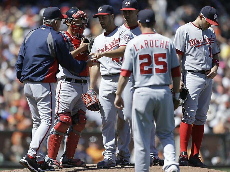 Washington Nationals' Gio Gonzalez, center, is removed from the baseball game against the San Francisco Giants in the eighth inning Wednesday, May 22, 2013, in San Francisco. (AP Photo/Ben Margot) Photo: Ben Margot, Associated Press