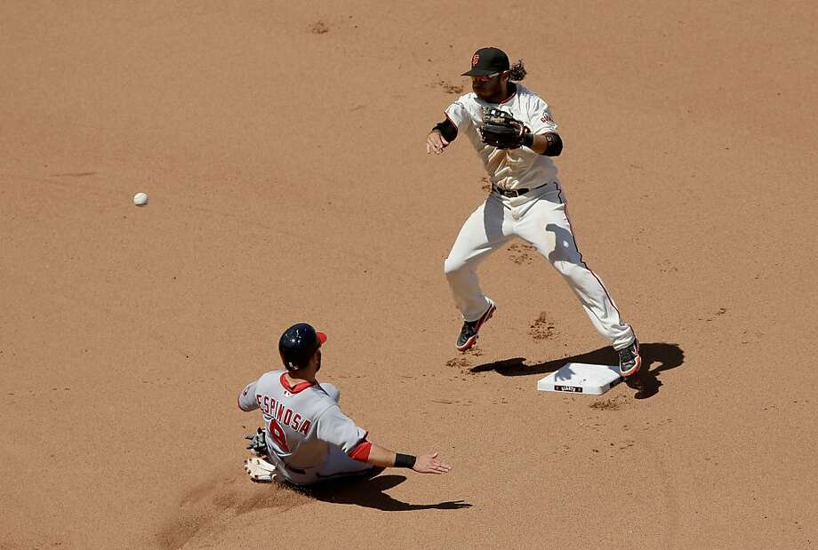SAN FRANCISCO, CA - MAY 22:  Brandon Crawford #35 of the San Francisco Giants tries to turn a double play as Danny Espinosa #8 of the Washington Nationals slides in to seond base in the seventh inning at AT&T Park on May 22, 2013 in San Francisco, California.  (Photo by Ezra Shaw/Getty Images) Photo: Ezra Shaw, Getty Images
