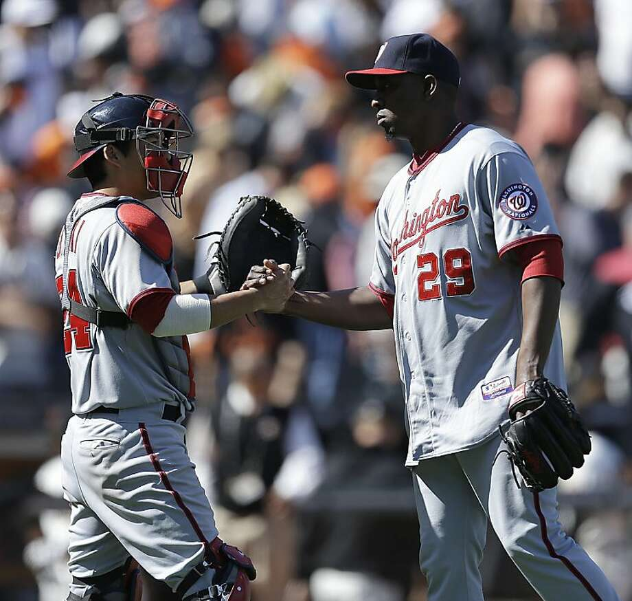 Washington Nationals' Rafael Soriano, right, elebrates with catcher Kurt Suzuki after defeating the San Francisco Giants in a baseball game on Wednesday, May 22, 2013, in San Francisco. (AP Photo/Ben Margot) Photo: Ben Margot, Associated Press
