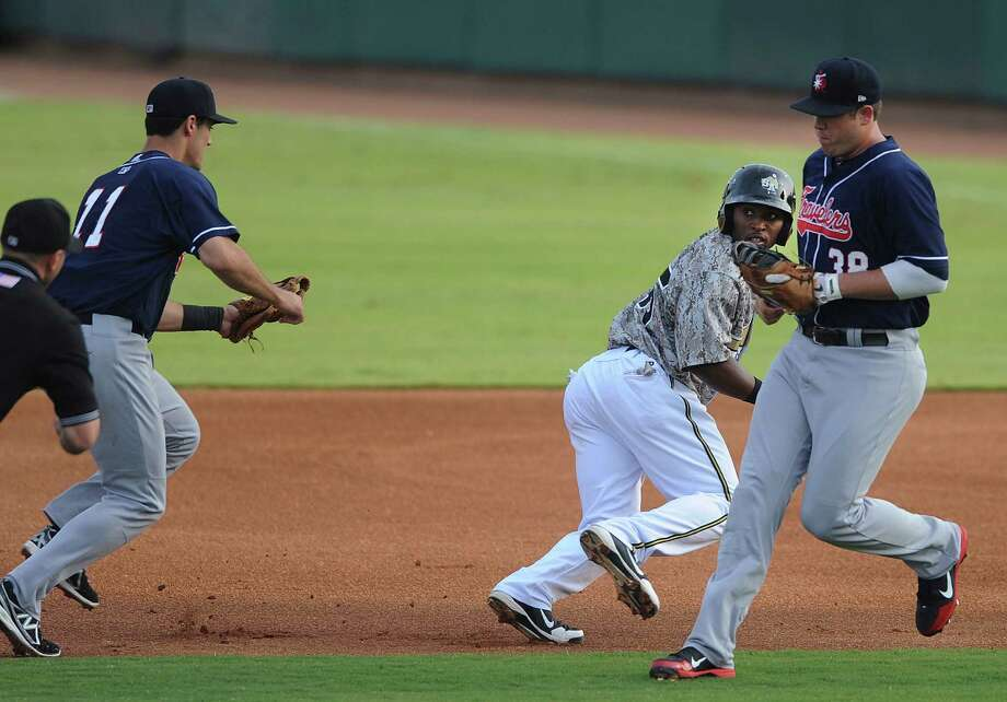 Everett Williams of the San Antonio Missions is caught in a rundown between first and second bases as Arkansas shortstop Jimmy Swift chases him down during Texas League action at Wolff Stadium on Wednesday, May, 22, 2013. Photo: Billy Calzada, San Antonio Express-News / San Antonio Express-News