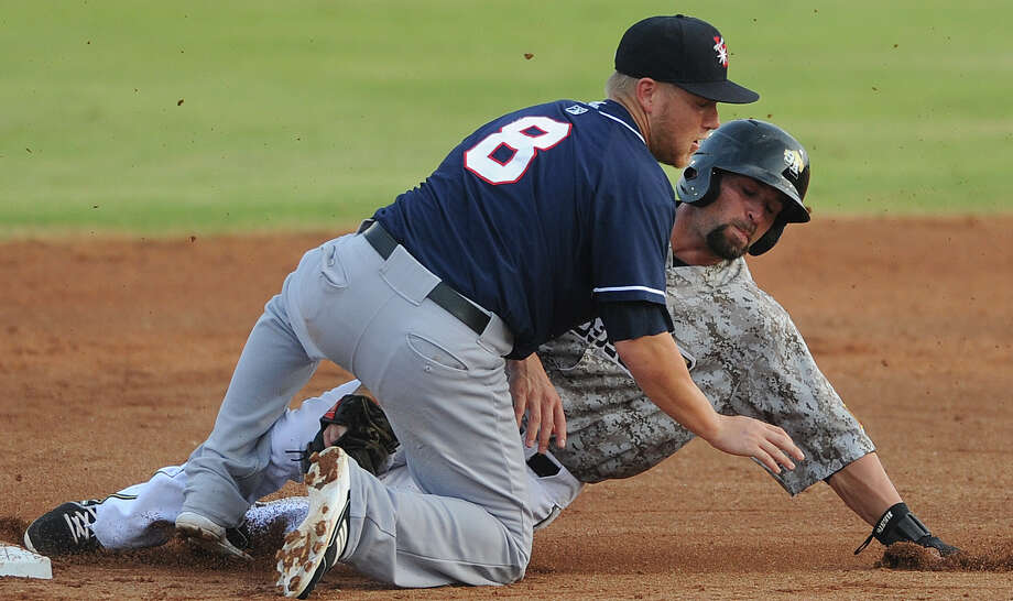 Jake Blackwood of the San Antonio Missions is tagged out by Taylor Lindsey of the Arkansas Travelers on a double-steal attempt during Texas League action at Wolff Stadium on Wednesday, May, 22, 2013. Photo: Billy Calzada, San Antonio Express-News / San Antonio Express-News