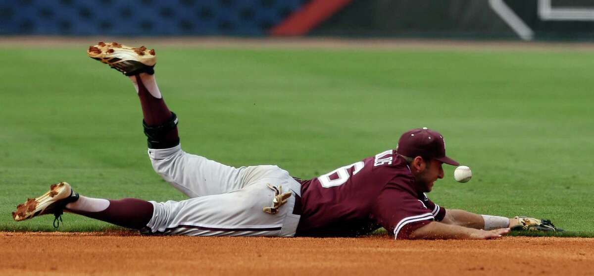 Texas A&M short stopTroy Stein can't get to a base hit by Vanderbilt's Xavier Turner during the first inning of a Southeastern Conference tournament college baseball game at the Hoover Met in Hoover, Ala., Wednesday, May 22, 2013. (AP Photo/Dave Martin)