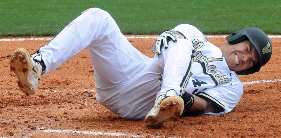 Vanderbilt's Zander Wiel reacts after fouling the ball off his leg during a SEC Baseball Tournament college game against Texas A&M at the Hoover Metropolitan Stadium in Hoover, Ala., Wednesday, May 22, 2013. Wiel stayed in the game. (AP Photo/AL.com, Mark Almond)  MAGAZINES OUT Photo: Mark Almond, Associated Press / AL.com