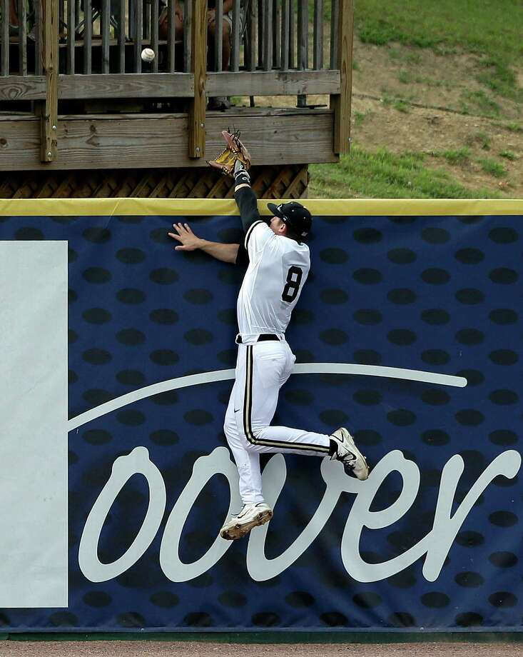 Vanderbilt left fielder Rhett Wiseman can't a home run ball hit by Texas A&M's Hunter Melton in the second inning of their college baseball game at the Southeastern Conference tournament in Hoover, Ala., Wednesday, May 22, 2013. (AP Photo/Dave Martin) Photo: Dave Martin, Associated Press / AP