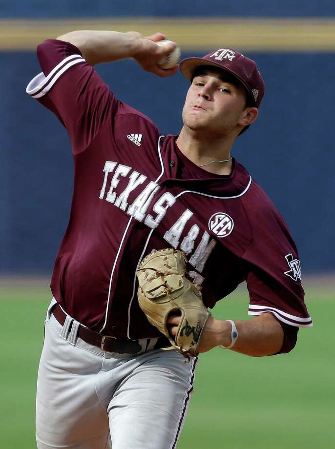 Texas A&M's Parker Ray pitches in the first inning of their Southeastern Conference Tournament college baseball game against Vanderbilt at the Hoover Met in Hoover, Ala., Wednesday, May 22, 2013. (AP Photo/Dave Martin) Photo: Dave Martin, Associated Press / AP