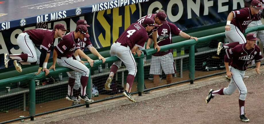 Texas A&M players react at the end of a 5-0 win over Vanderbilt in their Southeastern Conference Tournament college baseball game at the Hoover Met in Hoover, Ala., Wednesday, May 22, 2013. (AP Photo/Dave Martin) Photo: Dave Martin, Associated Press / AP
