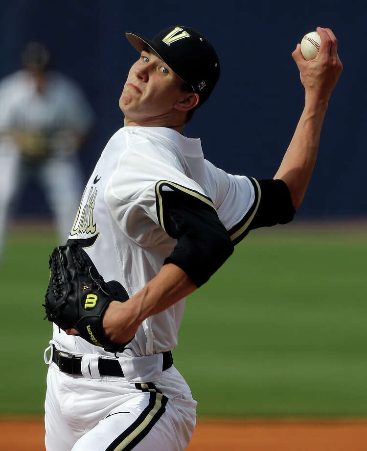 Vanderbilt's Walker Buehler pitches in the first inning of their Southeastern Conference Tournament college baseball game against Texas A&M at the Hoover Met in Hoover, Ala., Wednesday, May 22, 2013. (AP Photo/Dave Martin) Photo: Dave Martin, Associated Press / AP