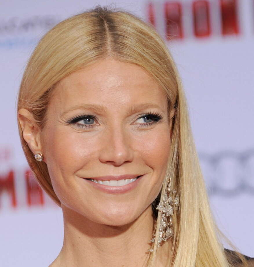 "HOLLYWOOD, CA - APRIL 24:  Actress Gwyneth Paltrow arrives at the Los Angeles premiere of ""Iron Man 3"" at the El Capitan Theatre on April 24, 2013 in Hollywood, California.  (Photo by Gregg DeGuire/WireImage)   Paltrow was named People Magazine's Most Beautiful Woman. Photo: Gregg DeGuire, WireImage / 2013 Gregg DeGuire"
