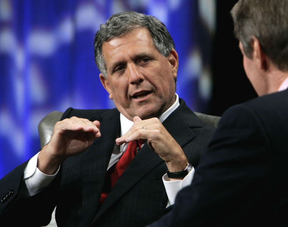 FILE -In this Tuesday, Sept. 12, 2006, file photo, Leslie Moonves, left, president and chief executive officer of CBS, talks with PBS host Charlie Rosein Beverly Hills, Calif. CEO pay has been going up, The highest paid CEO in 2012 was Leslie Moonves of CBS, who made $60.3 million. Photo: Reed Saxon