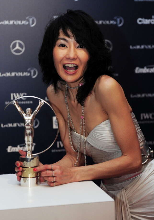 RIO DE JANEIRO, BRAZIL - MARCH 11:  Actress Maggie Cheung poses with the trophy at the 2013 Laureus World Sports Awards at the Theatro Municipal Do Rio de Janeiro on March 11, 2013 in Rio de Janeiro, Brazil. Photo: Jamie McDonald / 2013 Getty Images