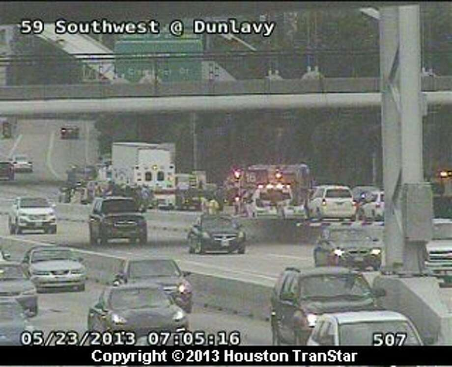 Traffic was slowed on the southbound Southwest Freeway near Shepherd after crash eaerly Thursday morning. Photo: Houston Transtar