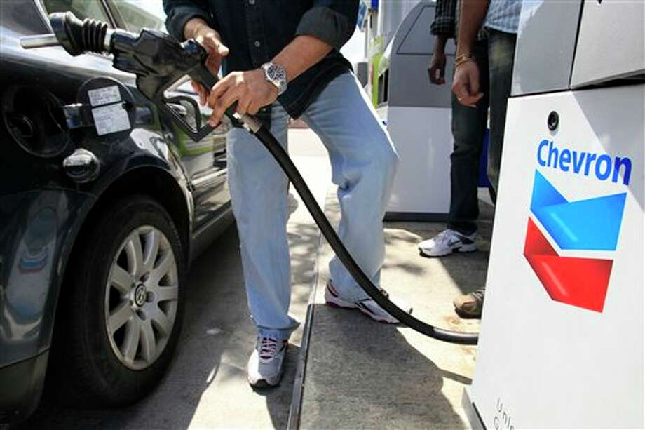 Total score: 100  Select criteria:  Prohibits descrimination based on sexual orientation: 15  Prohibits discrimination based on gender identity or expression: 15  Offers partner health/medical insurance: 15  Positively engages the external LGBT community: 15  A large-scale official or public anti-LGBT blemish on record: 0  (photo: A Chevron customer pumps gas in Mountain View, Calif.) Photo: Paul Sakuma, AP / AP