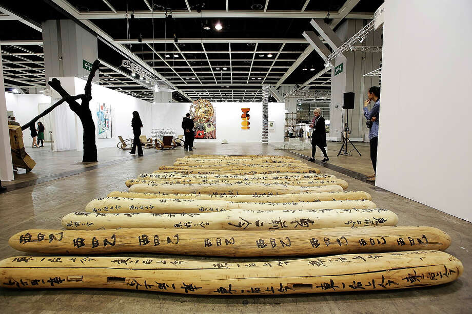 On the floor is a work called 'Fondle' 2009-2013 by Yang Xinguangon, the artist is represented by Boers- Li Gallery at Art Basel Hong Kong, May 22, 2013 in Hong Kong, Hong Kong. Photo: Jessica Hromas, Getty Images / 2013 Getty Images