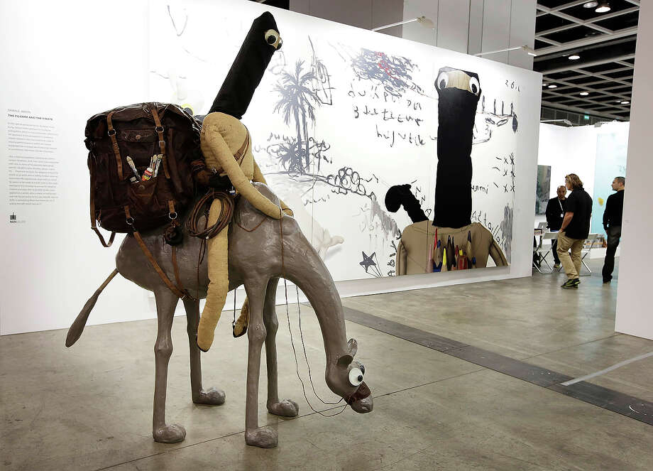 Art Basel, the modern art festival that began in Basel, Switzerland in 1907 and expanded to Miami in 2002 is debuting in Asia this year. Each year, Art Basel attracts many of the wealthiest modern art collectors in the world.Above:'The Pilgrim and the Pirate' by Samsul Arifin, represented by the Nadi Gallery, Jakarata, at Art Basel, May 22, 2013 in Hong Kong. Photo: Jessica Hromas, Getty Images / 2013 Getty Images