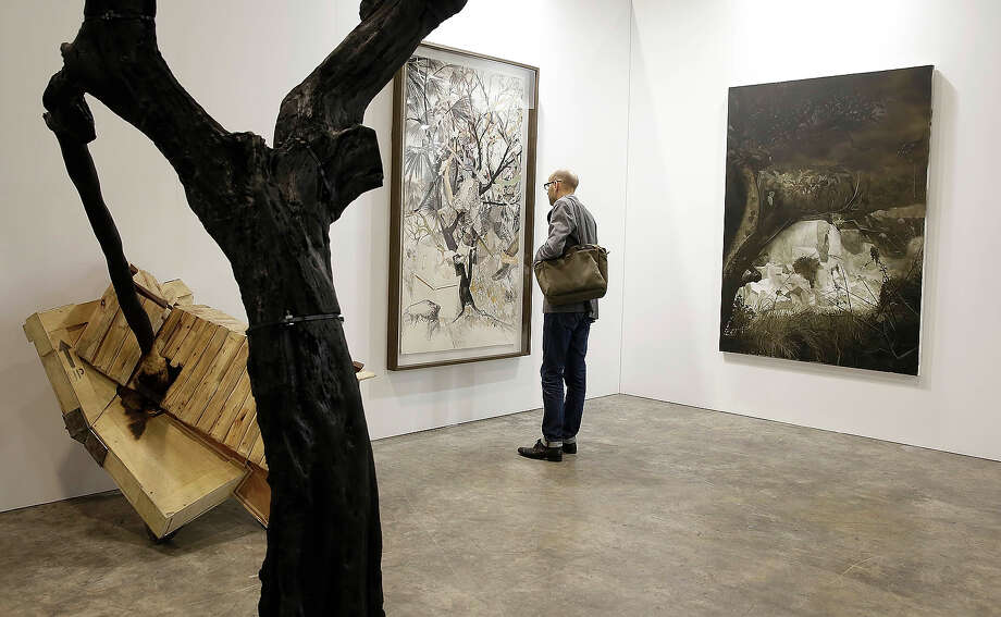 A man looks at work from the Boers- Li Gallery at Art Basel, May 22, 2013 in Hong Kong. Photo: Jessica Hromas, Getty Images / 2013 Getty Images