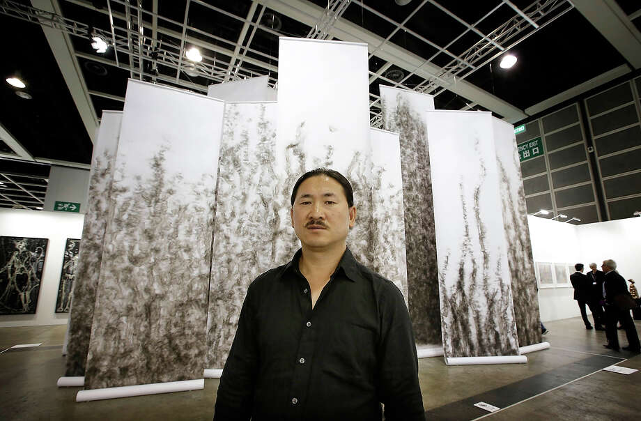 "Artist Qin Chong stands in front of his instillation called ""Losing"", represented by Galerie du Monde at Art Basel , May 22, 2013 in Hong Kong. Photo: Jessica Hromas, Getty Images / 2013 Getty Images"