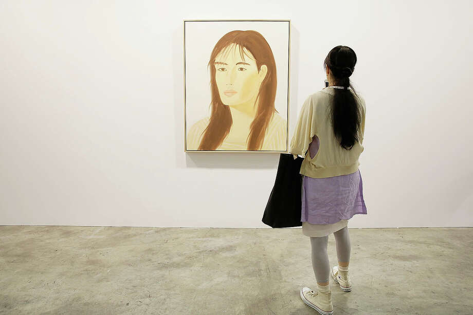 "A woman looks at a painting called ""Mie"" 2008 by Alex Zatz represented by gallery Richard Gray at Art Basel , May 22, 2013 in Hong Kong. Photo: Jessica Hromas, Getty Images / 2013 Getty Images"