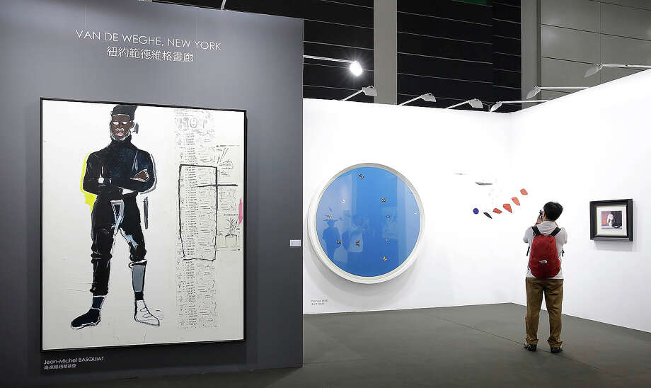 """MP"" 1984 by Jean-Michel Basquiat and ""Blue Angel"" 2005 by Damien Hurst, represented by gallery Van De Weghe, New York at Art Basel, May 22, 2013 in Hong Kong. Photo: Jessica Hromas, Getty Images / 2013 Getty Images"