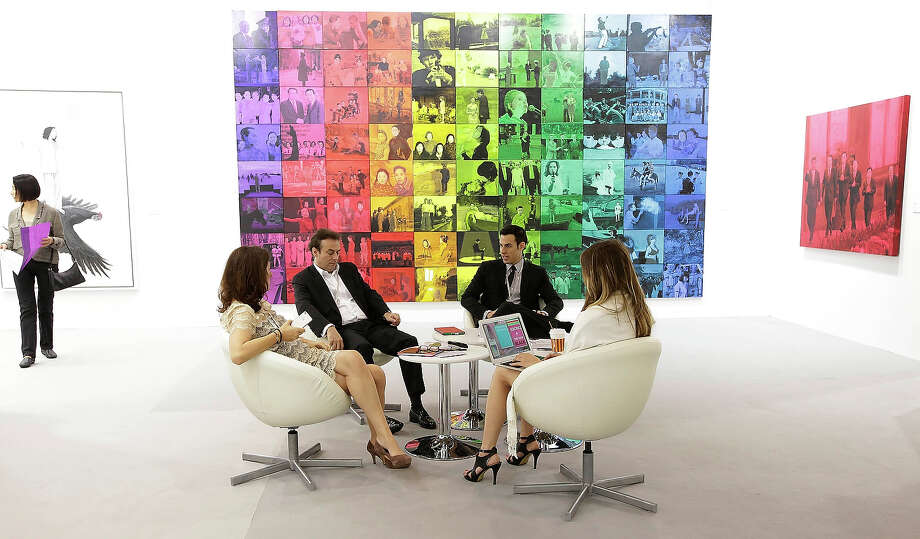 People sit in the de Sarthe gallery space at Art Basel in Hong Kong, May 22, 2013 in Hong Kong. Photo: Jessica Hromas, Getty Images / 2013 Getty Images