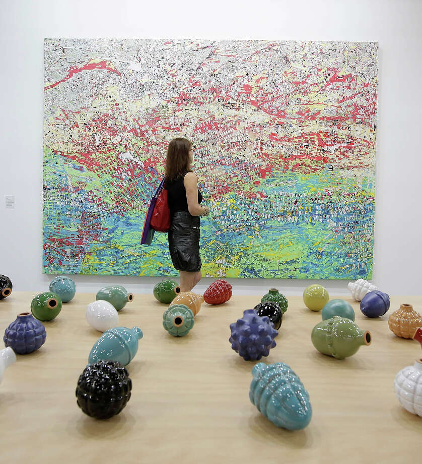 "A woman looks at a painting called ""Dragon"" 2012  by Mark Bradford, represented by The White Cube gallery, at Art Basel in Hong Kong, May 22, 2013 in Hong Kong. Photo: Jessica Hromas, Getty Images / 2013 Getty Images"