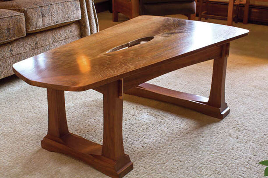 A table made by John Olenik, in the living  room of his home on Monday April 15, 2013 in Ballston Spa, NY.  This table got its gap when John Olenik butterflied an asymmetrical piece of wood and brought the two pieces together. The result? Gorgeous imperfection. Photo: Philip Kamrass / Philip Kamrass 2013