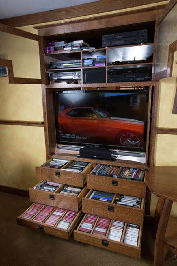 An entertainment center made by John Olenik in the basement of his home,  on Monday April 15, 2013 in Ballston Spa, NY. Photo: Philip Kamrass / Philip Kamrass 2013