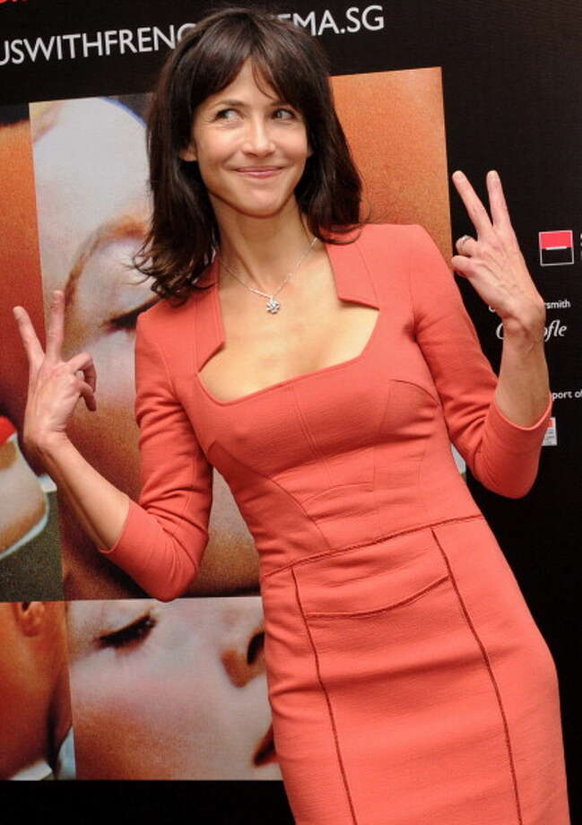 "This is what 46 looks like:  French actress Sophie Marceau gestures at a media conference to promote her new movie ""Happiness Never Comes Alone"" as part of the French Film Festival in Singapore on December 5, 2012. French film ""Happiness Never Comes Alone"" (Un bonheur n'arrive jamais seul), directed by James Huth, makes its Southeast Asian debut with its star Sophie Marceau will have its premier screening at The Cathay in Singapore. AFP PHOTO / ROSLAN RAHMAN Photo: ROSLAN RAHMAN, AFP/Getty Images / 2012 AFP"