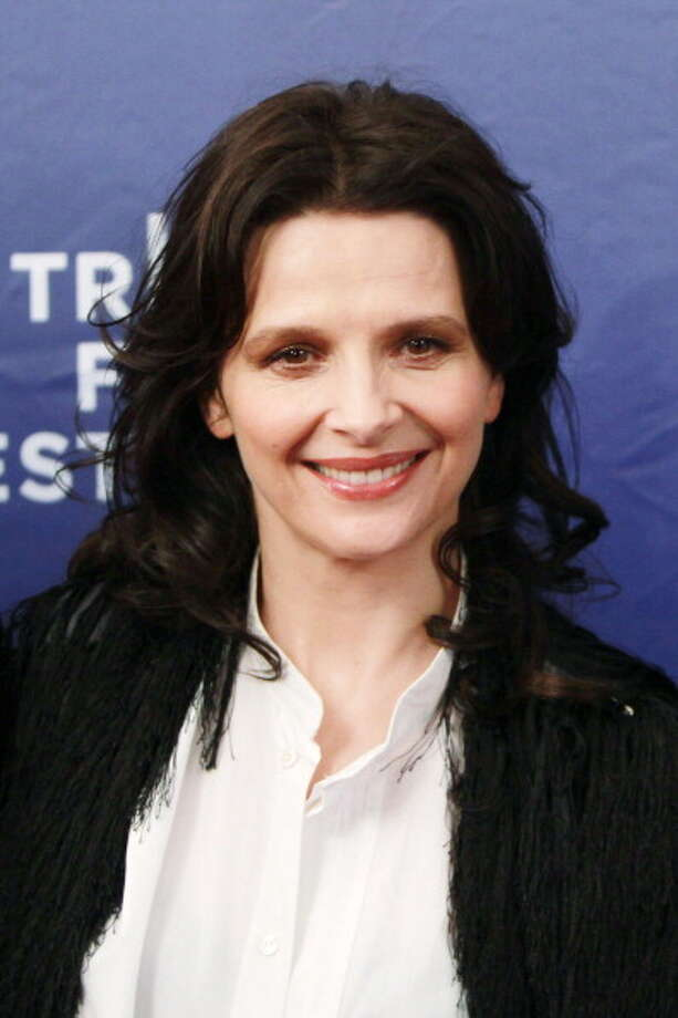 French actress Juliette Binoche attends the premiere Elles during the 2012 Tribeca Film Festival at BMCC/TPAC in New York on April 22, 2012.      AFP PHOTO/Mehdi Taamallah Photo: AFP, AFP/Getty Images / 2012 AFP