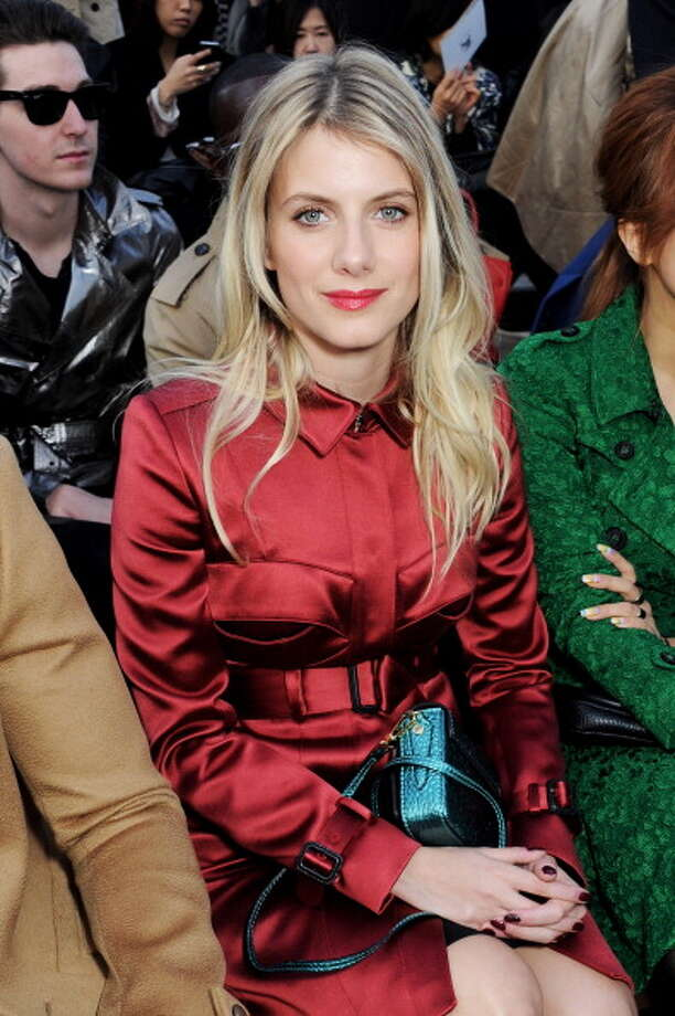 LONDON, ENGLAND - FEBRUARY 18:  Melanie Laurent sits in the front row for the Burberry Prorsum Autumn Winter 2013 Womenswear Show at Kensington Gardens on February 18, 2013 in London, England. Photo: Dave M. Benett / 2013 Dave M. Benett