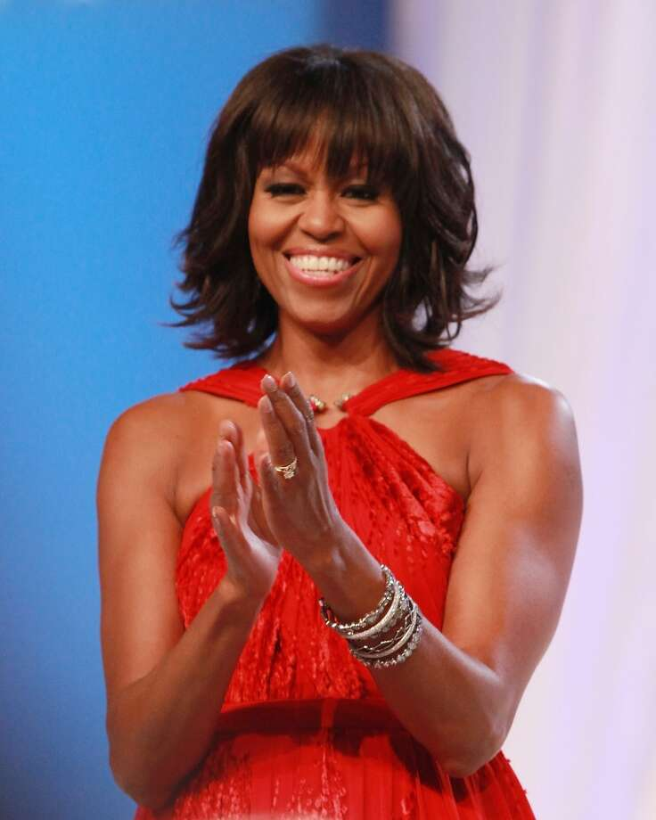 "While many famous heads went pixie, our first lady Michelle Obama demonstrated that all the modern mom needs is bangs. Early in the year, the FLOTUS sparked a Twitter storm with her new bangs, which she now has taken to sweeping to the side because, as she told Parade magazine, ""You know, it's hard to make speeches with hair in your face!"""