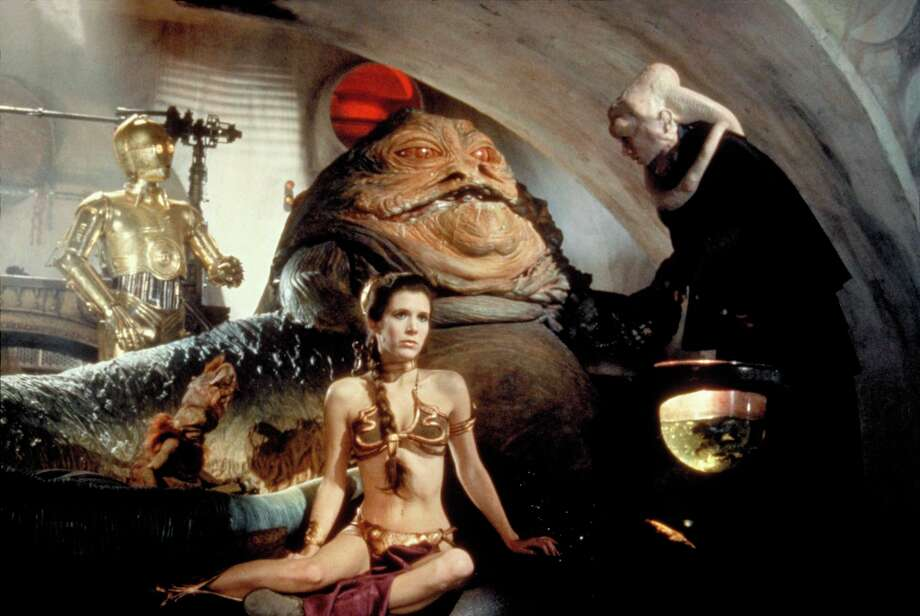 "Jabba the Hutt – bad manager, gross being. Pictured: Jabba the Hutt with Princess Leia (Carrie Fisher, foreground) in ""Return of the Jedi.""   Lucasfilm Ltd. & TM. All Rights Reserved. Photo: Courtesy"