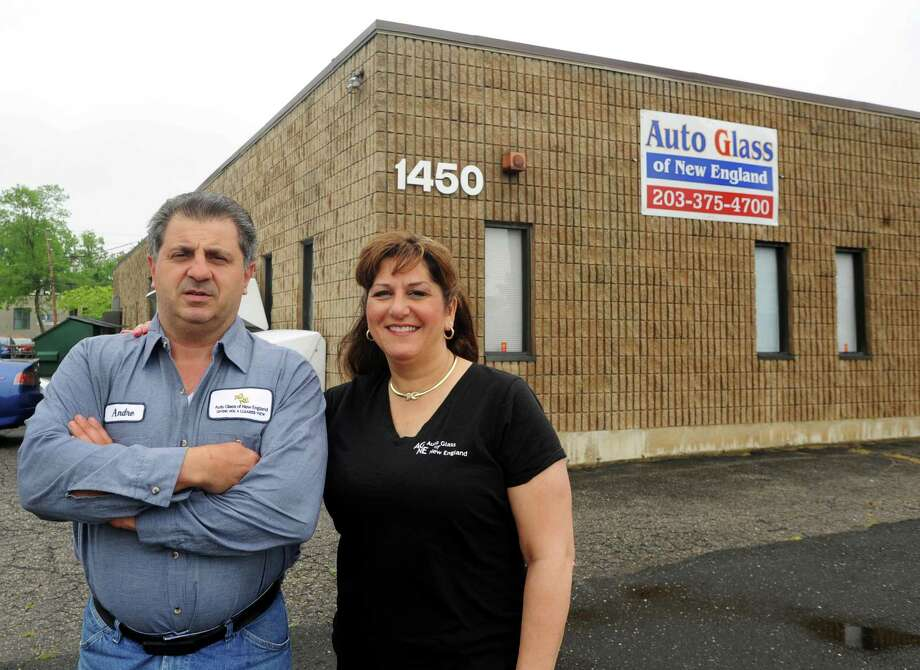 Andre and Roseann Santamaria at their place of business, Auto Glass of New England in Stratford, Conn. on Thursday, May 23, 2013. A bill that won final approval in the Senate would benefit mom-and-pop auto glass shops by preventing insurance companies from automatically steering consumers to a glass company to which they are affiliated. Photo: Cathy Zuraw / Connecticut Post