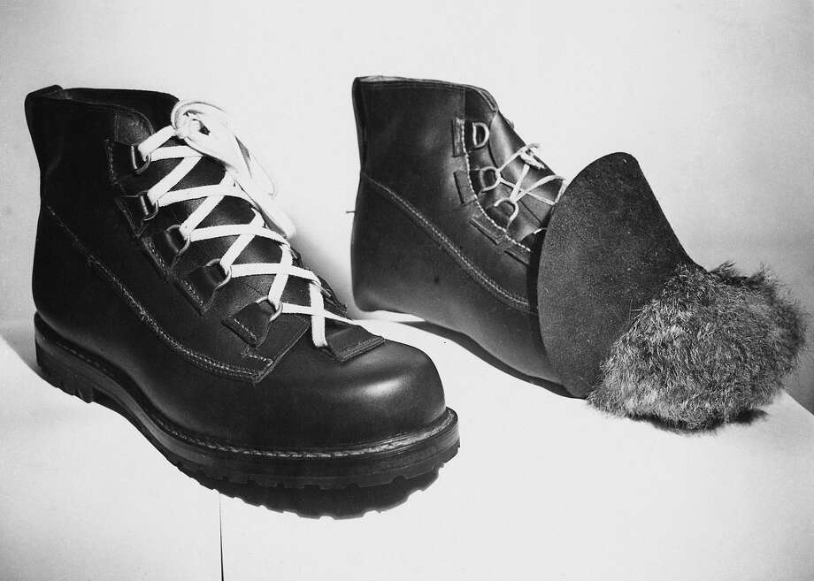 Boots being handmade for Edmund Hillary's Mount Everest expedition, 21st January 1953. The boot on the right is still under construction, and the fur interlining can be seen. They are being made by Messrs. Robert Lawrie Ltd of London, and should be durable at heights of 23,000 feet. Photo: Ron Burton, Getty Images / 2011 Getty Images
