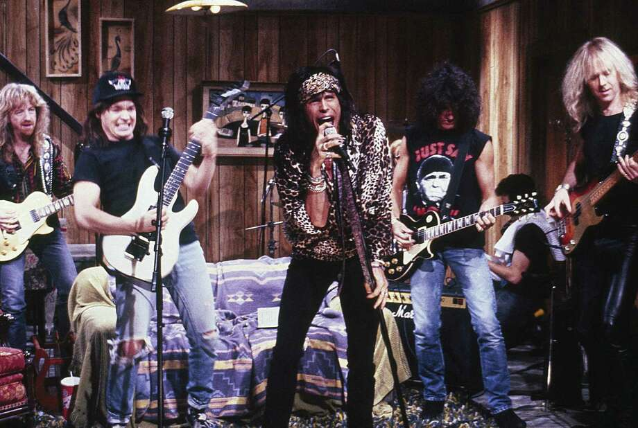 "Mike Myers as Wayne Campbell, Steven Tyler, Joe Perry, Brad Whitford during the ""Wayne's World"" skit on Feb. 17, 1990. (Photo by Ray Bonar/NBCU Photo Bank) Photo: NBC, Getty Images / © NBC Universal, Inc."