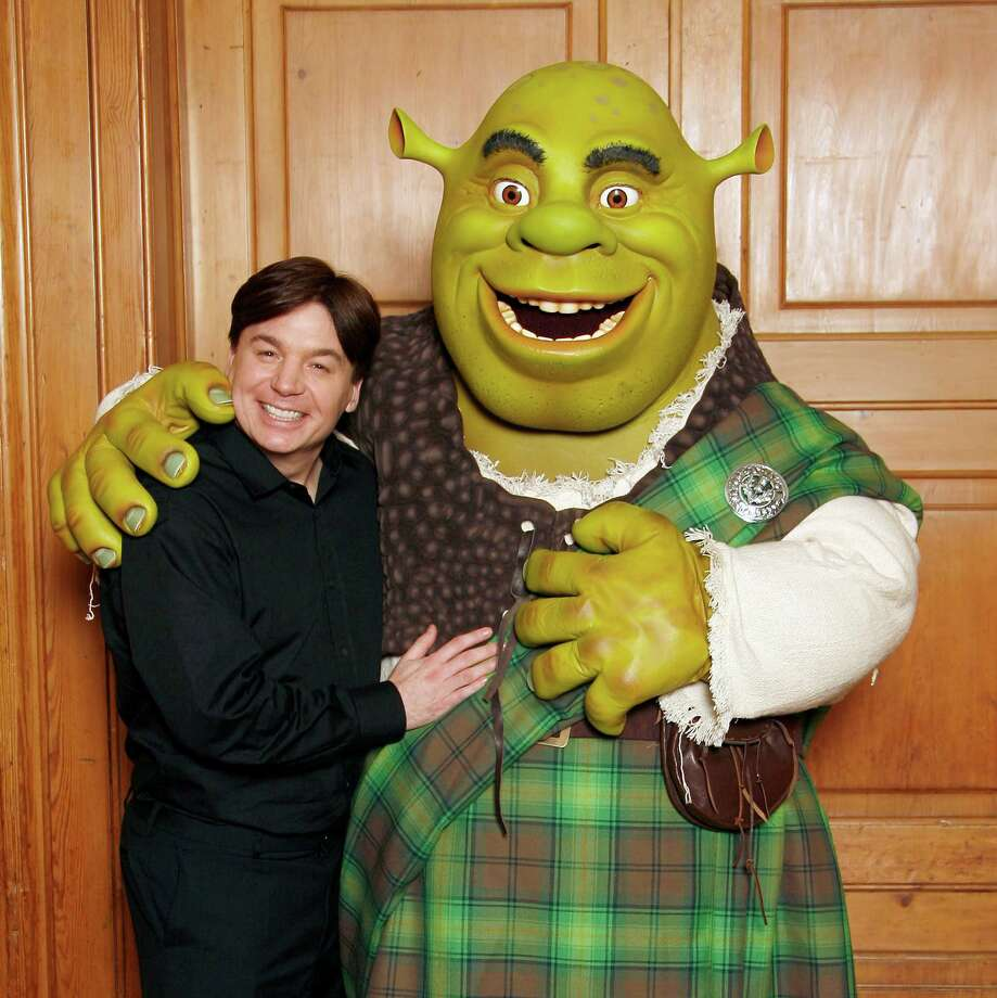 Mike Myers poses alongside Shrek after Shrek received official Scottish clan tartan at The Dorchester Hotel on June 11, 2007 in London. The tartan was specially woven in 'Shrek Green' design using traditional methods by kilt manufacturers Lochcarron. Photo: Gareth Davies, Getty Images / 2007 Gareth Davies