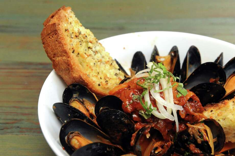 Mussels with a sambuca tomato broth at Carmine's Restaurant on Tuesday May 21, 2013 in Albany, N.Y. (Michael P. Farrell/Times Union) Photo: Michael P. Farrell